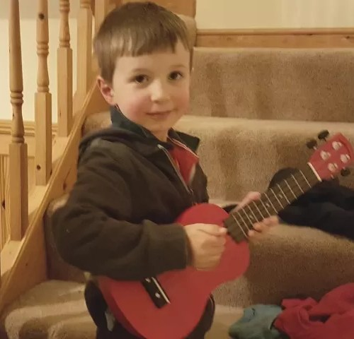 Playing his ukelele - Bubbablue and me Music Exploration