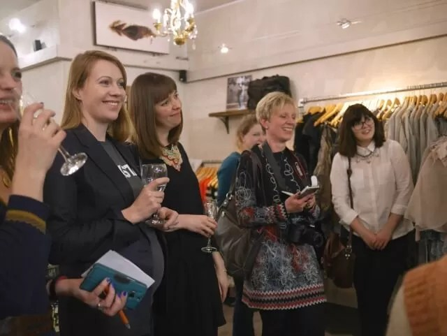 engrossed in styling tips at Olivia May