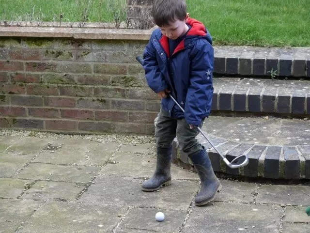trying out golf in the back garden
