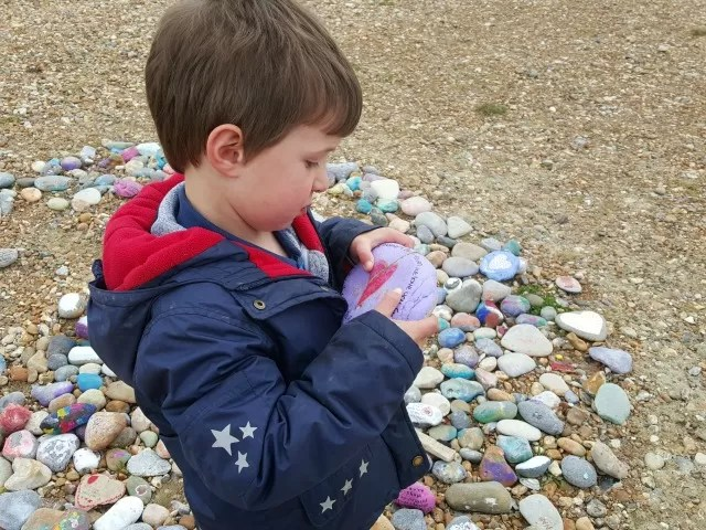 Matching up the broken stone on Eastbourne beach