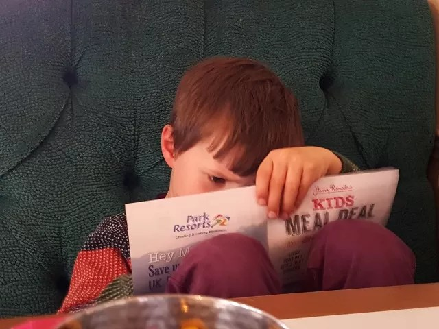 checking the menu at Harry Ramdsen