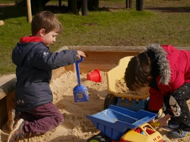playing in the sandpit at knockhatch adventure park