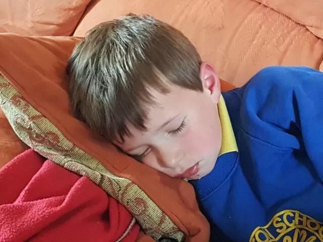 headache and falling asleep boy
