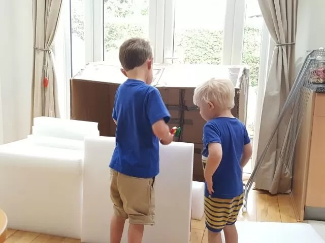 godbrothers playing with boxes