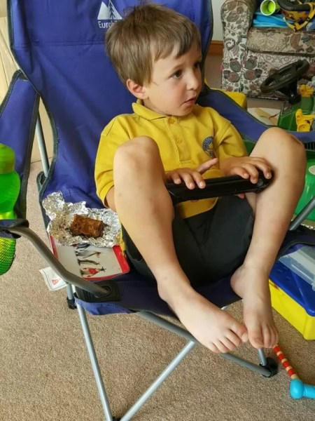 chilling out on his Eurohike camping chair