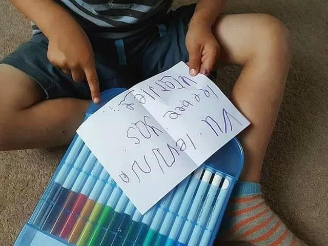 practising his writing