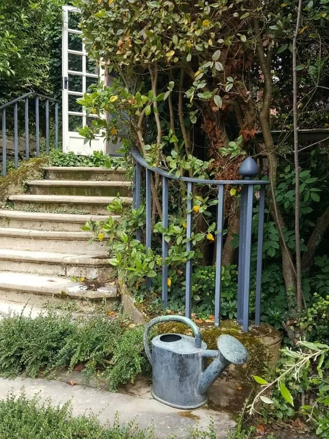steps and watering can at Hidcote gardens