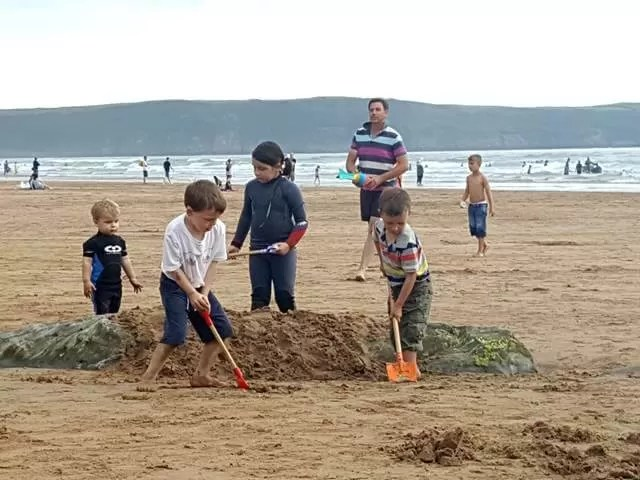 everyone digging on Woolacombe beach
