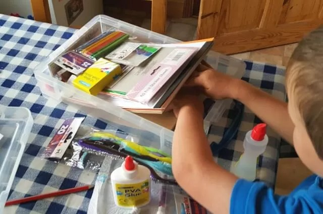 finding things in his craft box