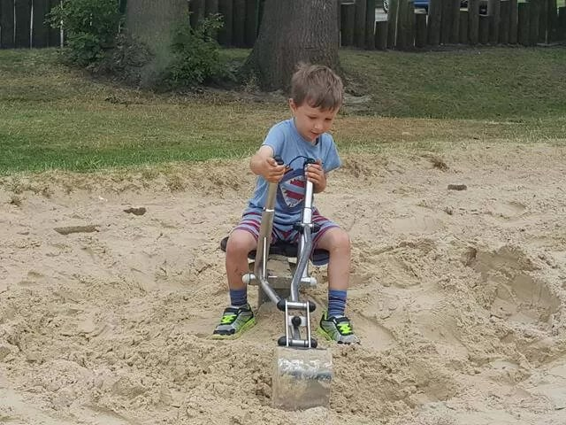 digging in the sandpit at the playground