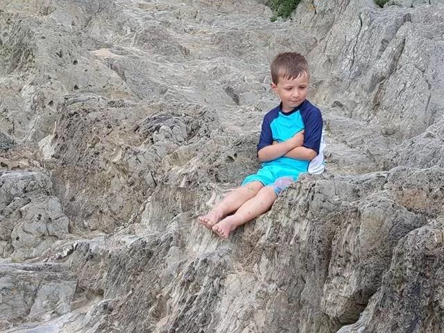 sitting on woolacombe rocks