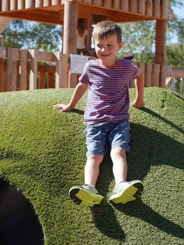 sliding-down-the-grass-tunnels