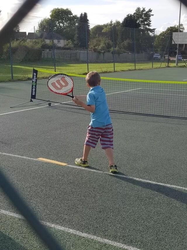 playing tennis at club