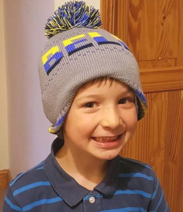 living arrows cutie in a bobble hat