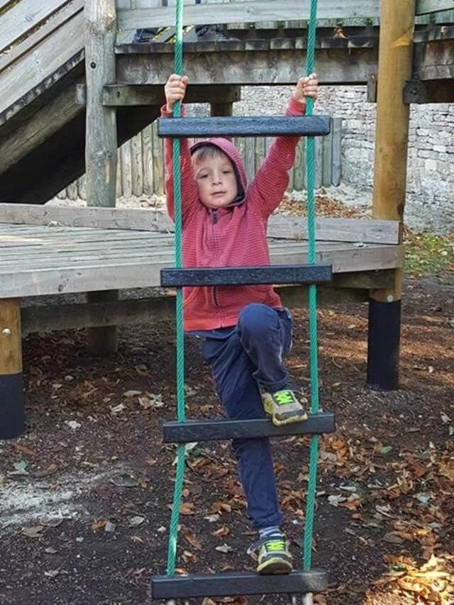 climbing a play rope ladder