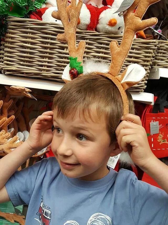 trying on reindeer ears