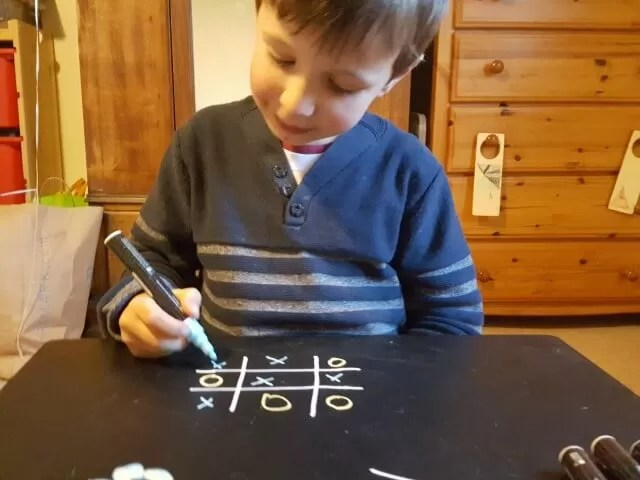 noughts and crosses on chalkboard
