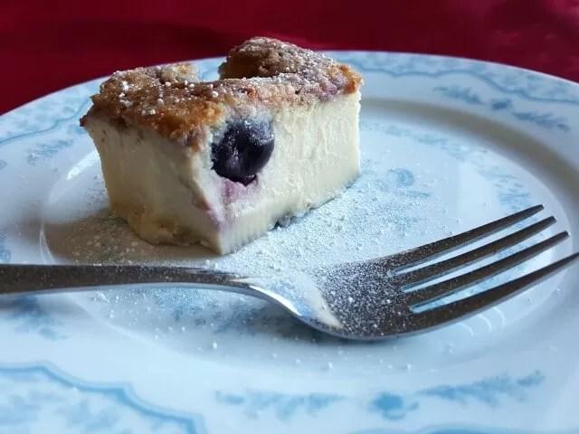 close up boozy cherry bakewell custard pudding