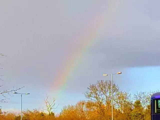 rainbow against grey sky