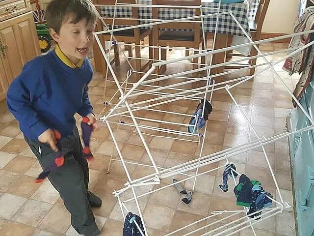helping with hanging up washing