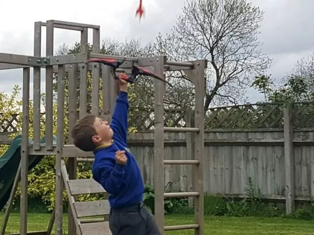 shooting arrows in the garden