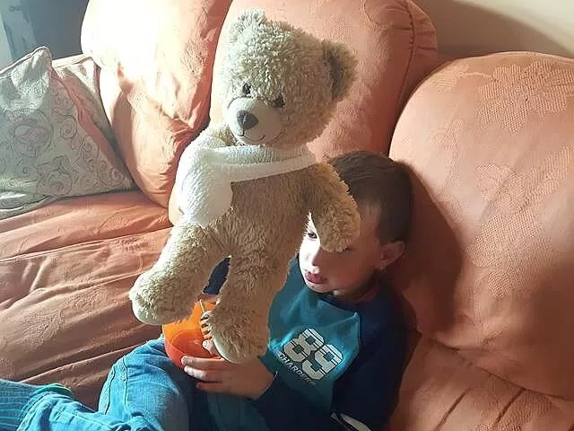 teddy bear with arm in slihng copying operation ouc