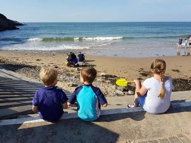 3 friends watching the sea at caswell bay