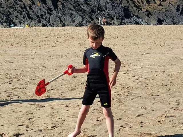 posing with a spade at 3 cliffs bay