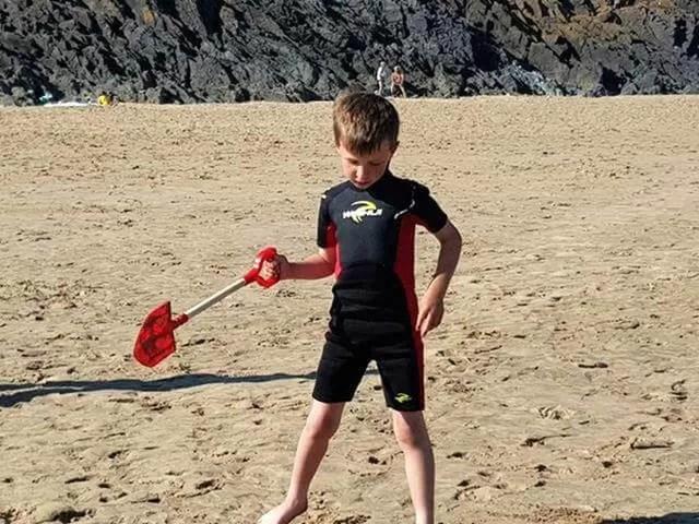 posing with a spade at 3 cliffs bay