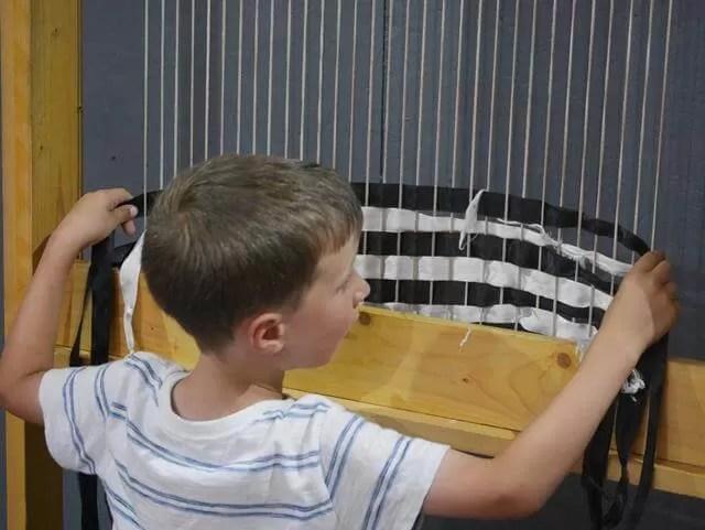 weaving ribbons at Roman Palace muscum