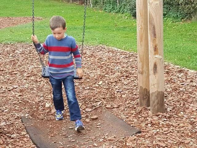 long legged boy on swings