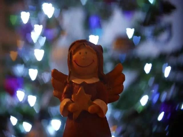angel and christmas lights bokeh