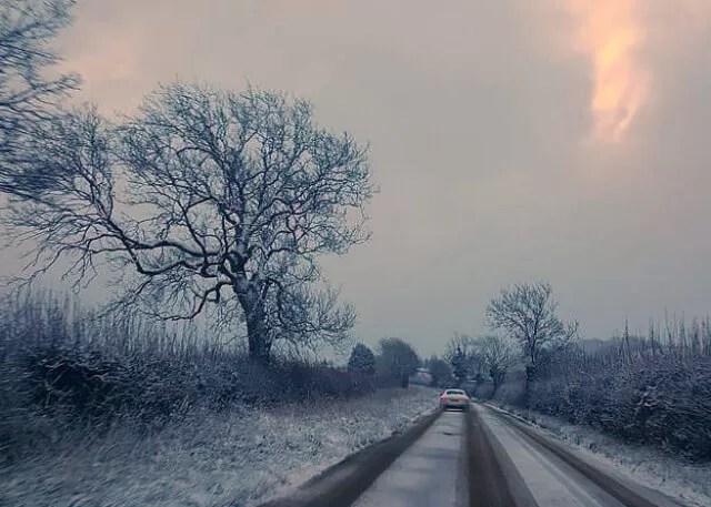 snowing rural road