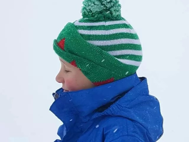 in the snow in an elf hat