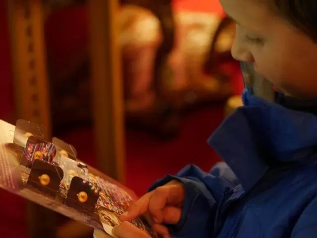 opening his waddesdon advent leaflet