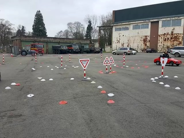 young driver firefly car track of cones