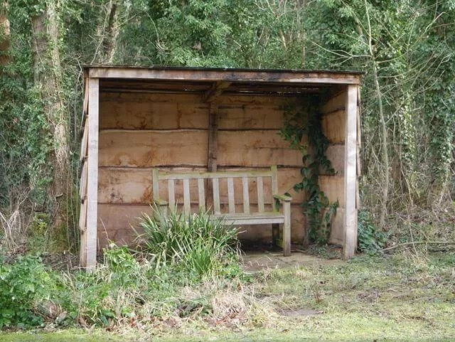 bench in a shelter at evenley wood garden