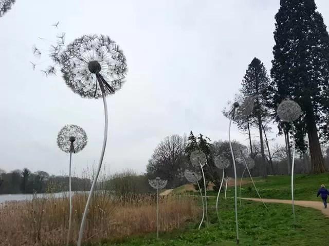 dandelion sculpture alongside the lake