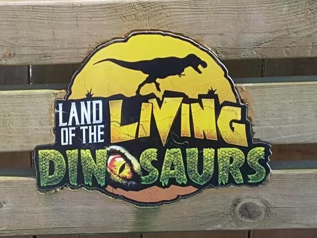land of living dinosaurs sign