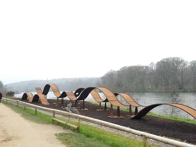 waves sculpture alongside the trentham lake