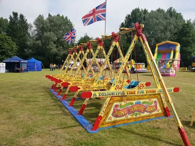 old fashioned swing boats at banbury show