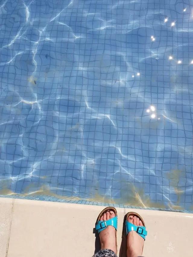 birkenstocks by the paddling pool