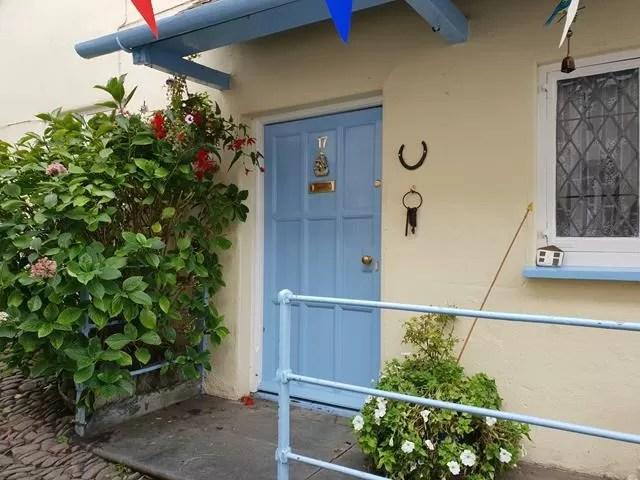 blue door at clovelly