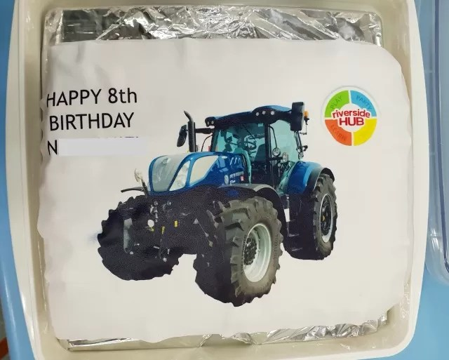 8th birthday cake with blue new holland tractor