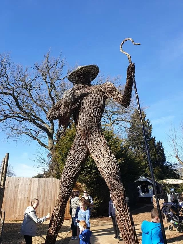 giant wooden man model.