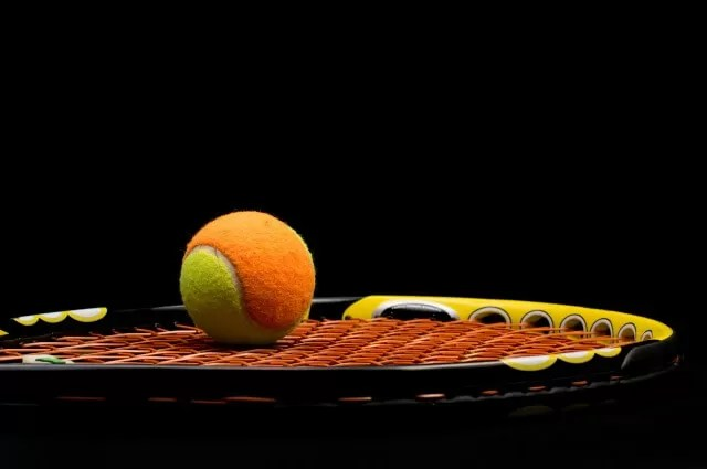 mini orange ball and racket