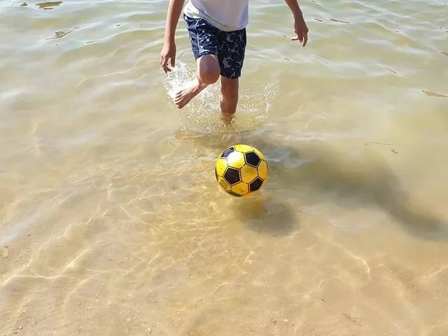 in cotswold beach with a ball
