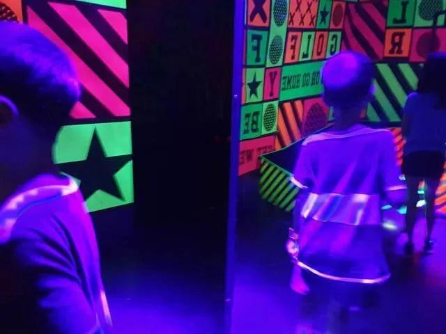 neon mirrors in junkyard golf