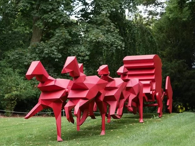 red horse and wagon sculpture