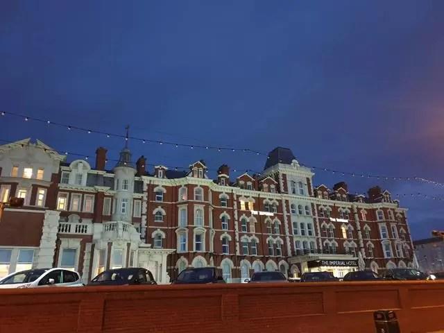 imperial hotel lit up at dusk